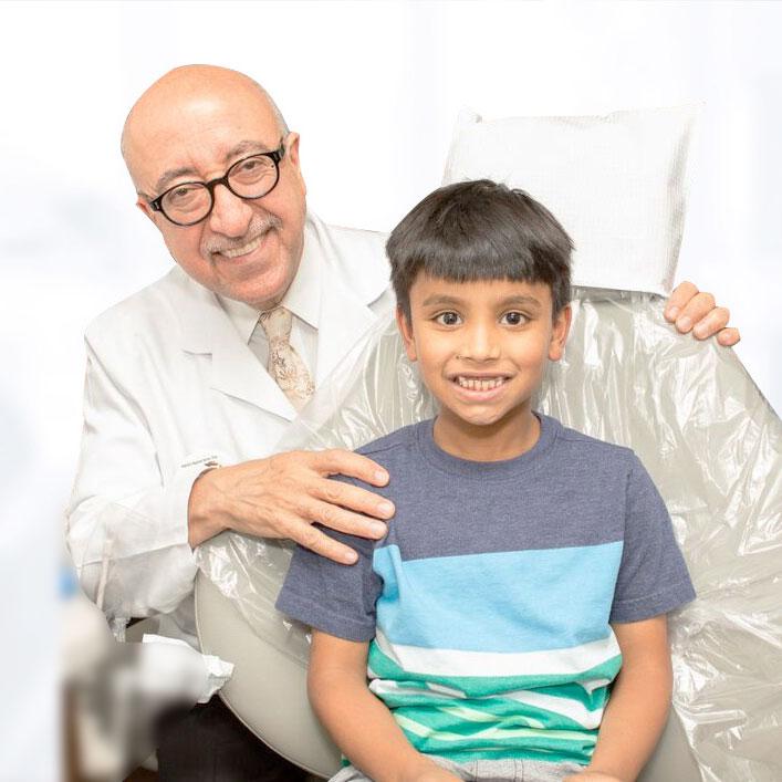 Dr. Farhad Moshiri with kid patient
